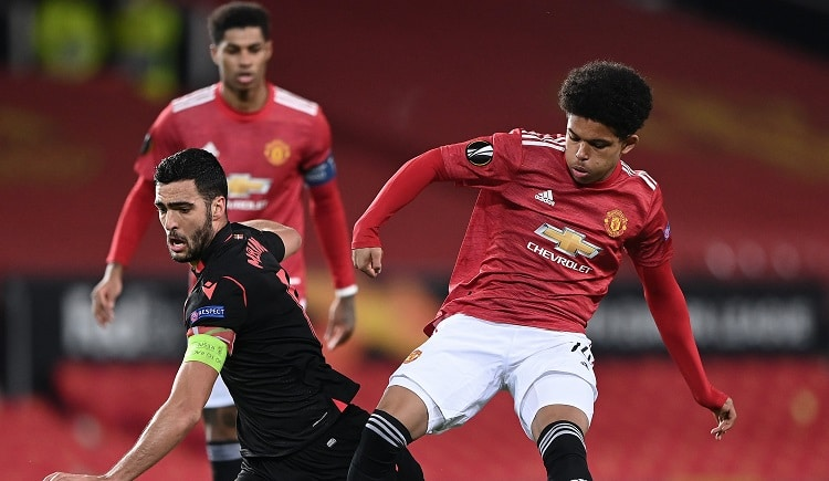 Manchester United held by Real Sociedad but coast into last 16